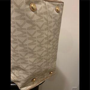 MK signature handbag.